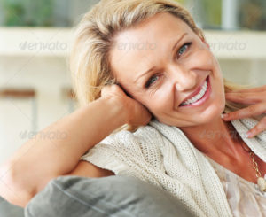 A cute middle aged female smiling