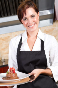 happy waitress holding dessert