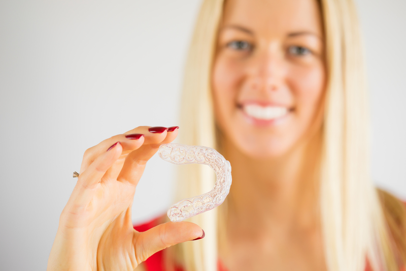 Why Do I Need Attachments on My Teeth During Invisalign? - Cory Liss Orthodontics - Orthodontists in Calgary - Featured Image